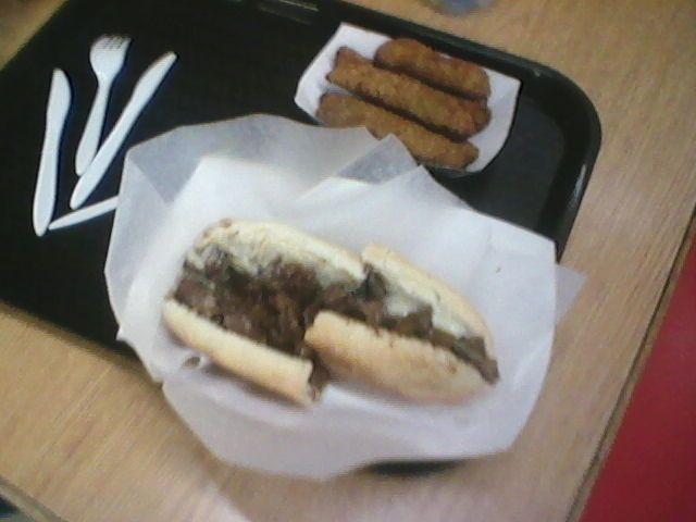 lower Steak Tips & Cheese above Fried Pickles