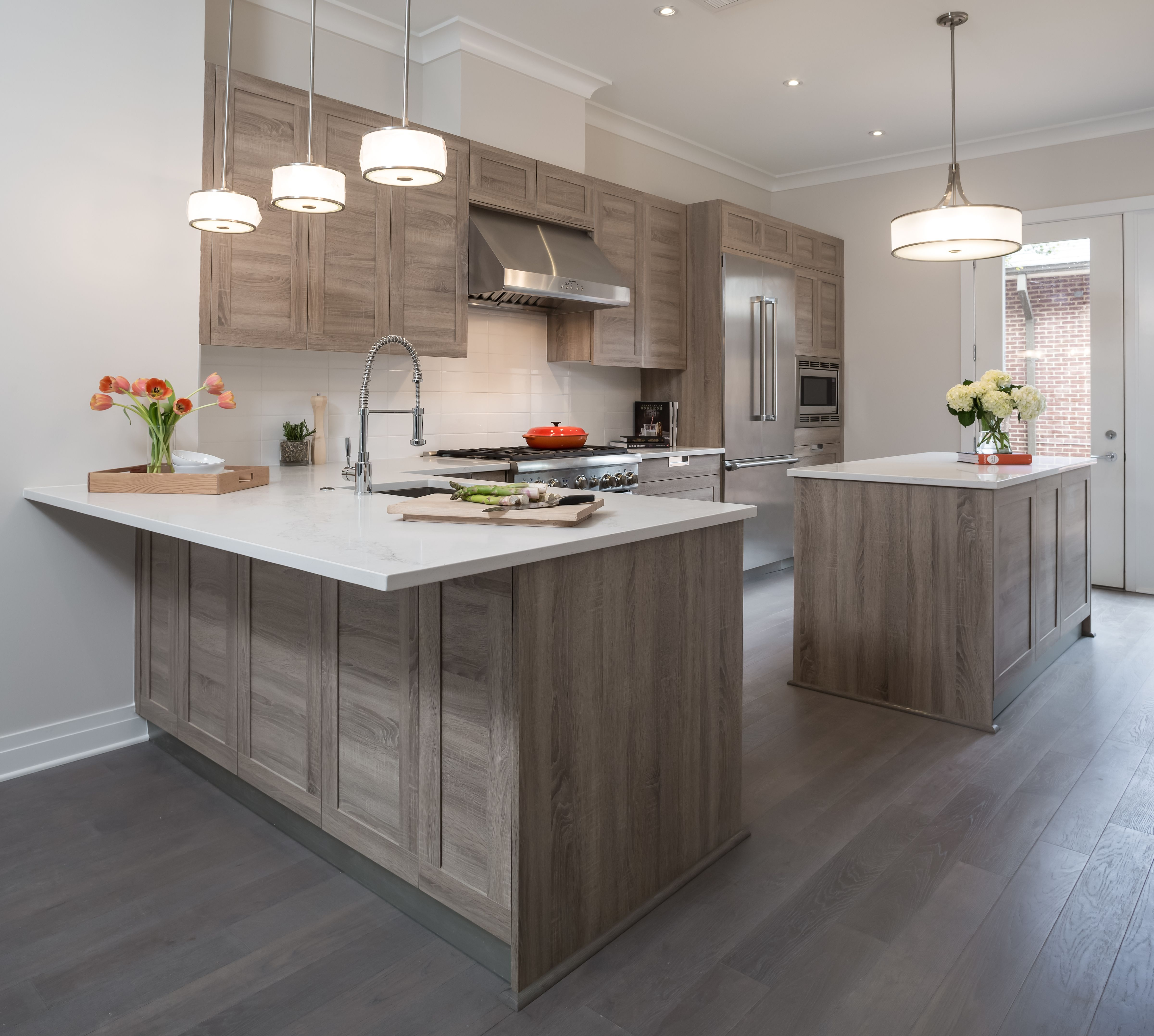 medium sized mid century modern kitchen idea in alexandria virginia with medium oak wood finish recessed panel cabinets and stainless steel appliances