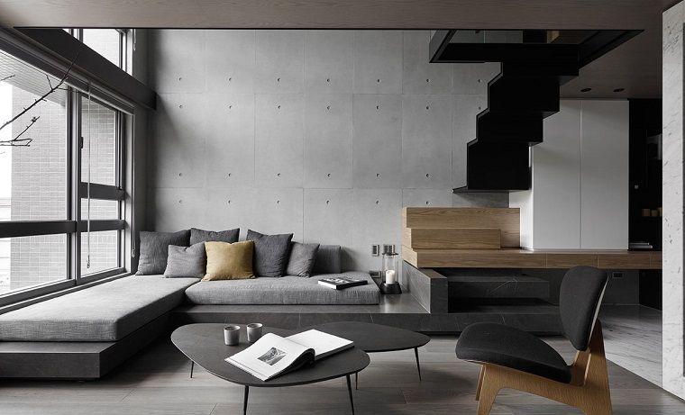 Stili di arredamento, soggiorno con un divano di colore grigio ad ...