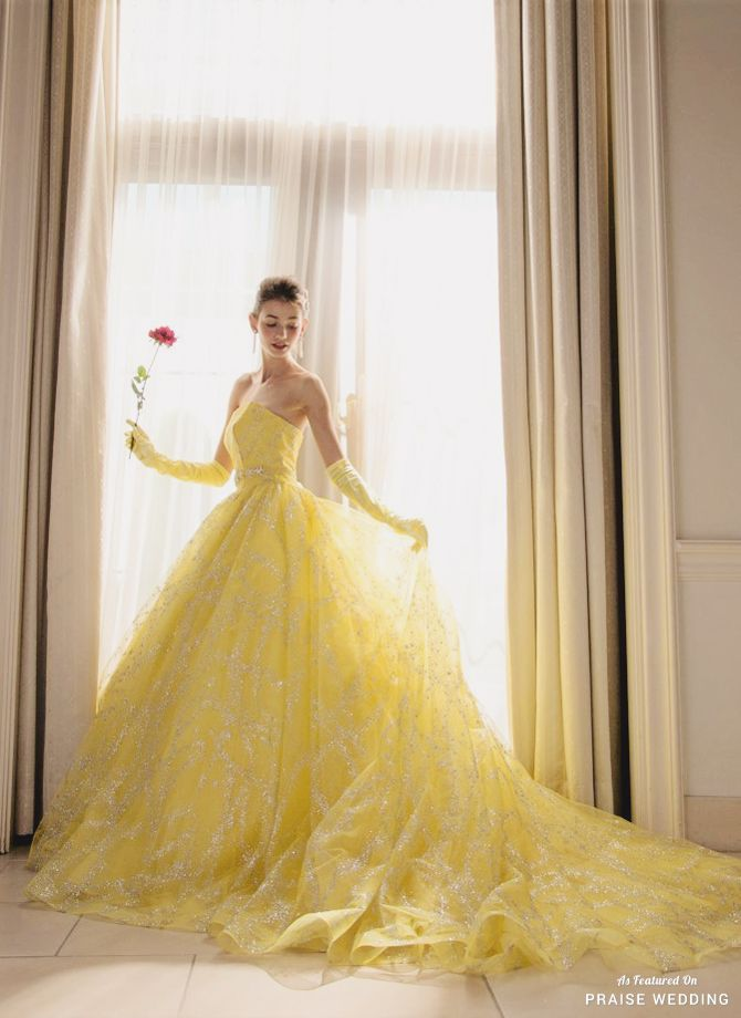 This Belle-inspired yellow gown from Kiyoko Hata featuring ...