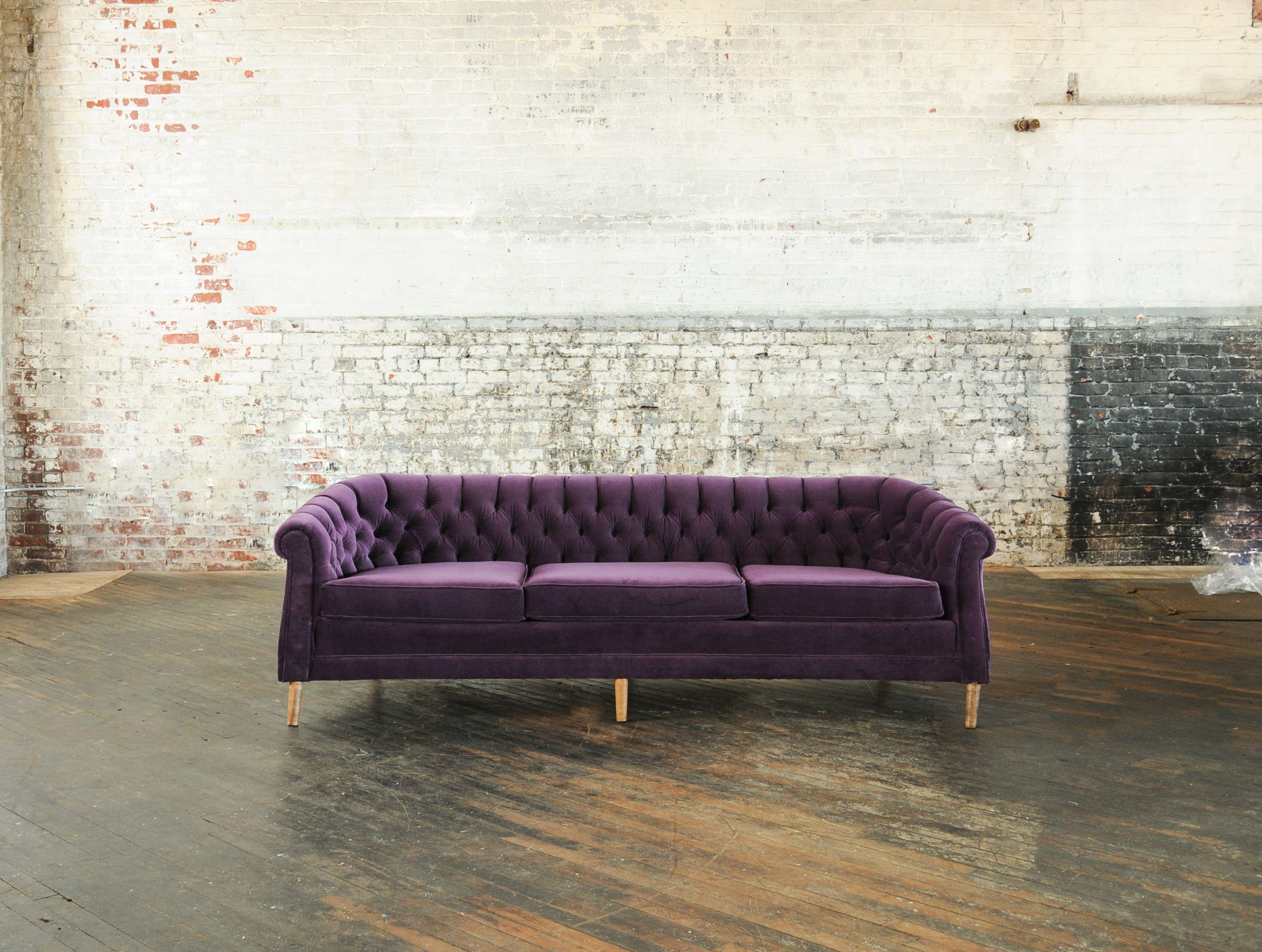 Eggplant Velvet Tufted Sofa.
