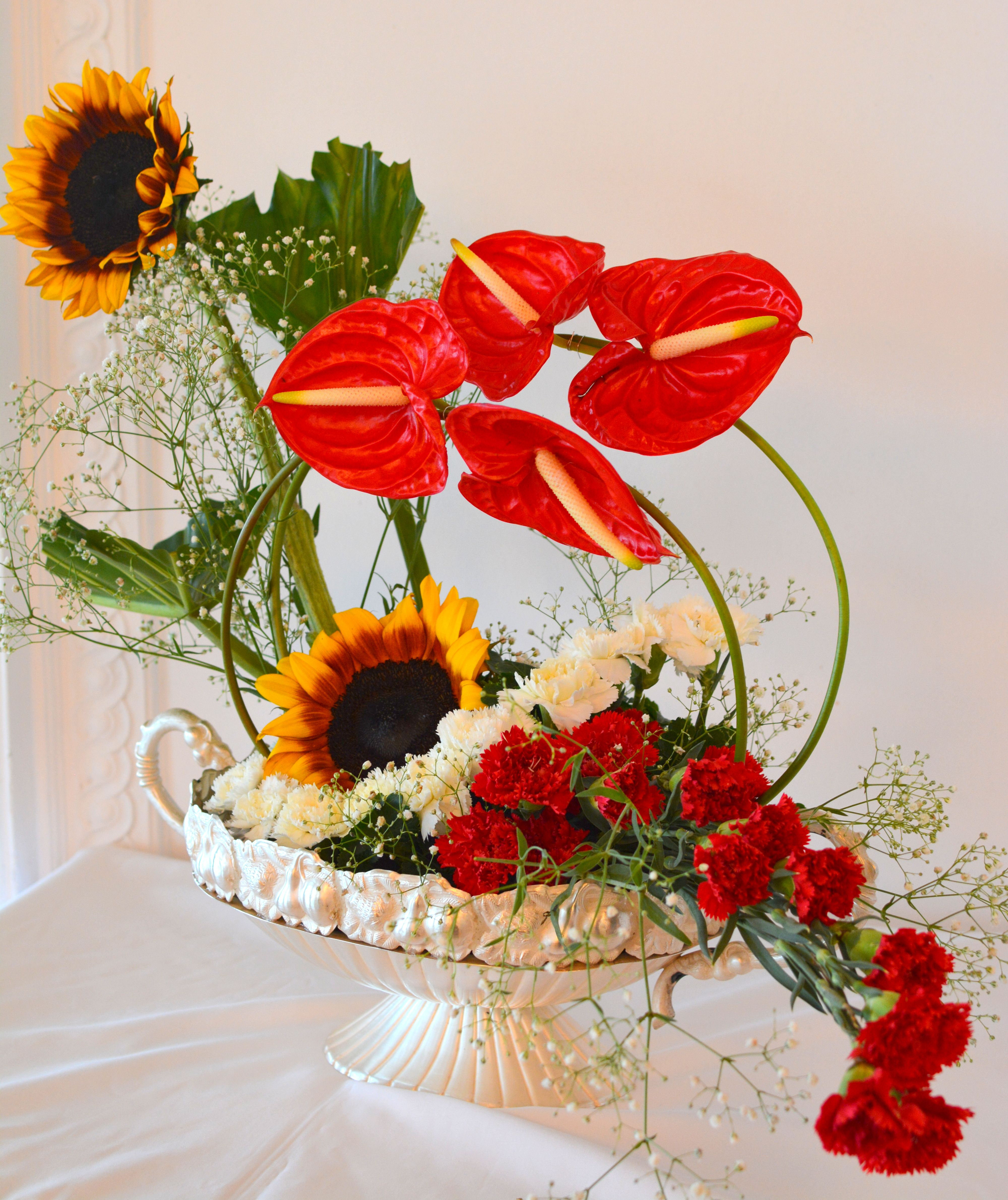 A bright arrangement of #SunFlowers #Anthuriums and #Carnations.  #FreshFlowers