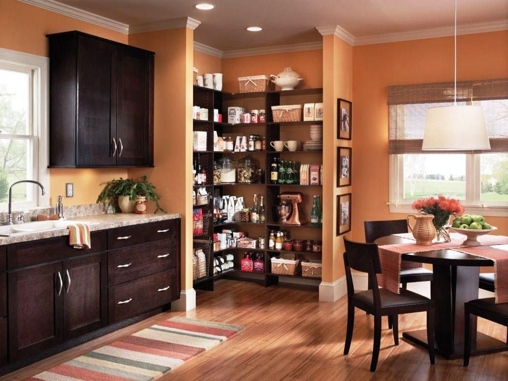 Stunning Modern Kitchen Pantry Design Set On The Wall Corner Including Dark  Wooden Backsplash Kitchen In The Nearby And Dining Table Set On Wood  Flooring ...