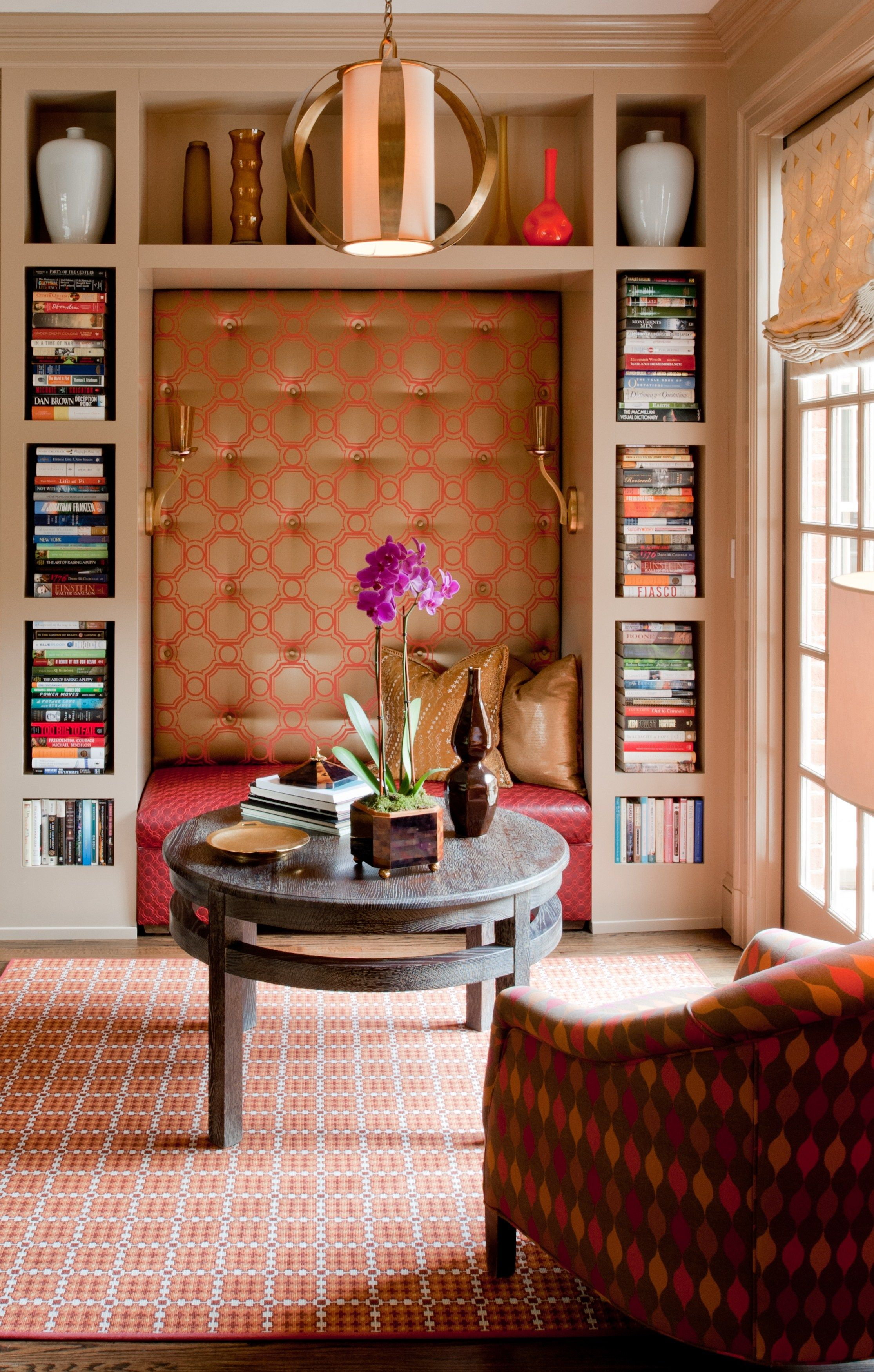 NIx the tacky colors. Like the concept of a reading nook in the bella sirena. Weathered wood backsplash. White cabinets. Grayish navy bench. Deeper with shelves. Overhead chandelier