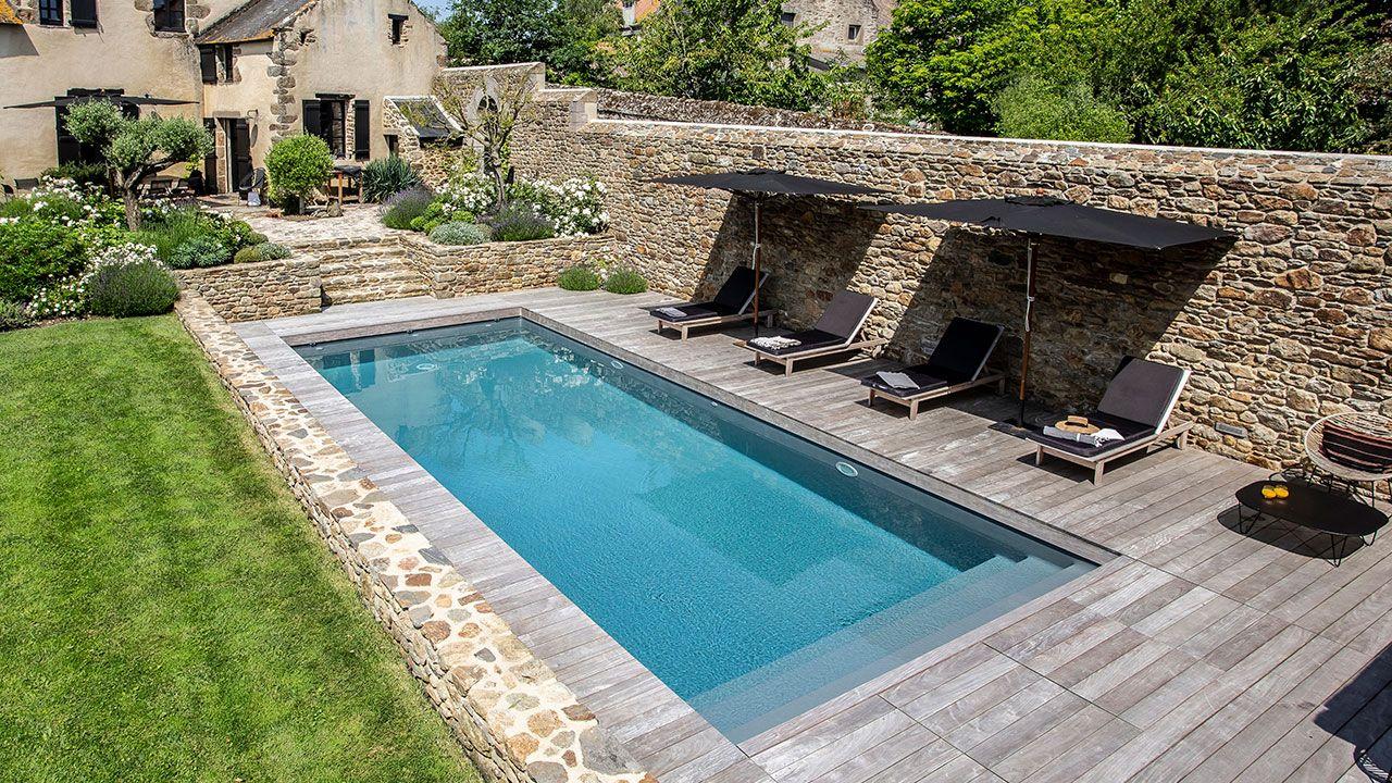 La piscine paysagée par l'esprit piscine 9,5 x 4,75 m