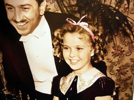 Shirley Temple with Walt Disney at the Oscars, 1939.