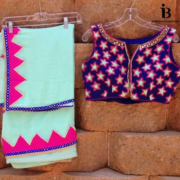 a classy yet casual wear saree with sleevless comtrasting blouse with mirror work embroidery.