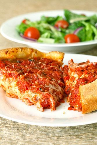 I love Pizzeria Uno and no homemade deep dish crust recipe has ever lived up to the real deal.  This recipe folds butter into dough layers like croissant dough... hmmmm.  Will have to try this one on my pizza quest.