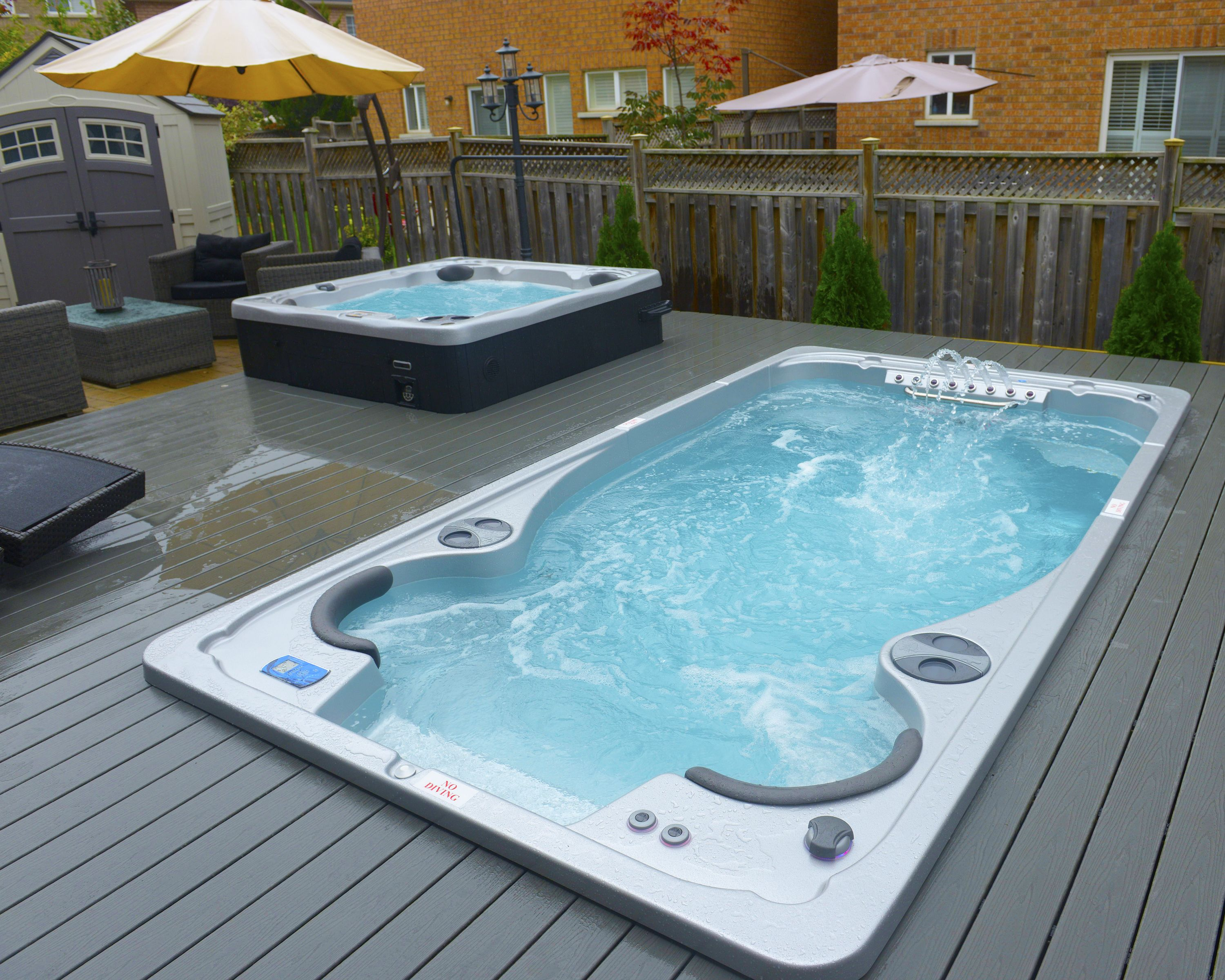 Jacuzzi Pool Installation Hydropool Self Cleaning Swim Spa And Hot Tub Installed Into A