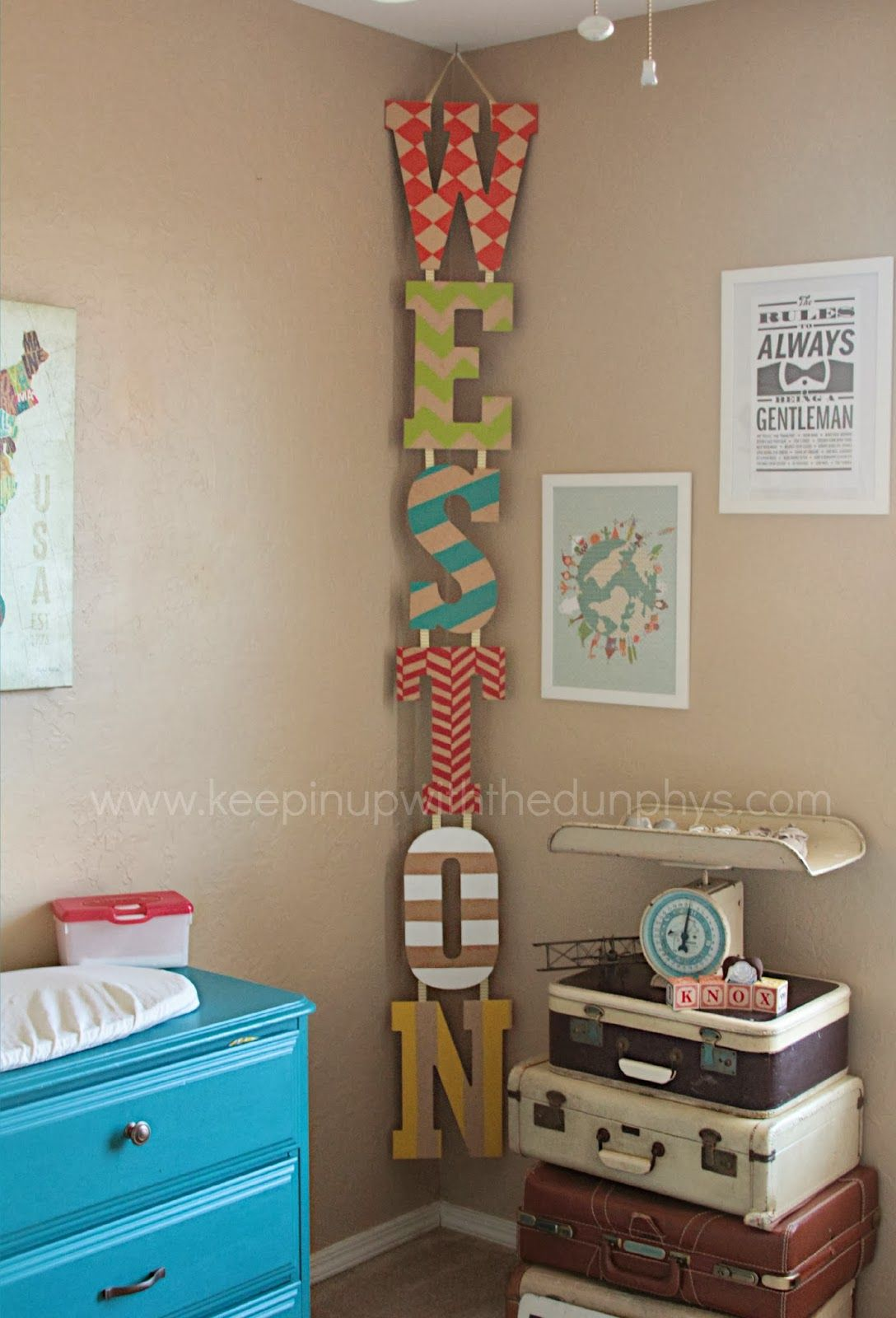hanging vertical kid's name in the corner - just decorate letters, attach  together, and
