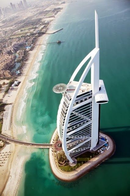 Burj al arab dubai soaring high like the sail of a huge for The sail hotel dubai