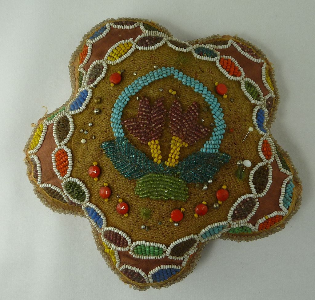 Beaded sewing collectible pin cushion round point star design