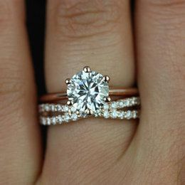i love the simple engagement ring with the added excitement of the criss crossing wedding band with smaller stones hw - Engagement And Wedding Rings