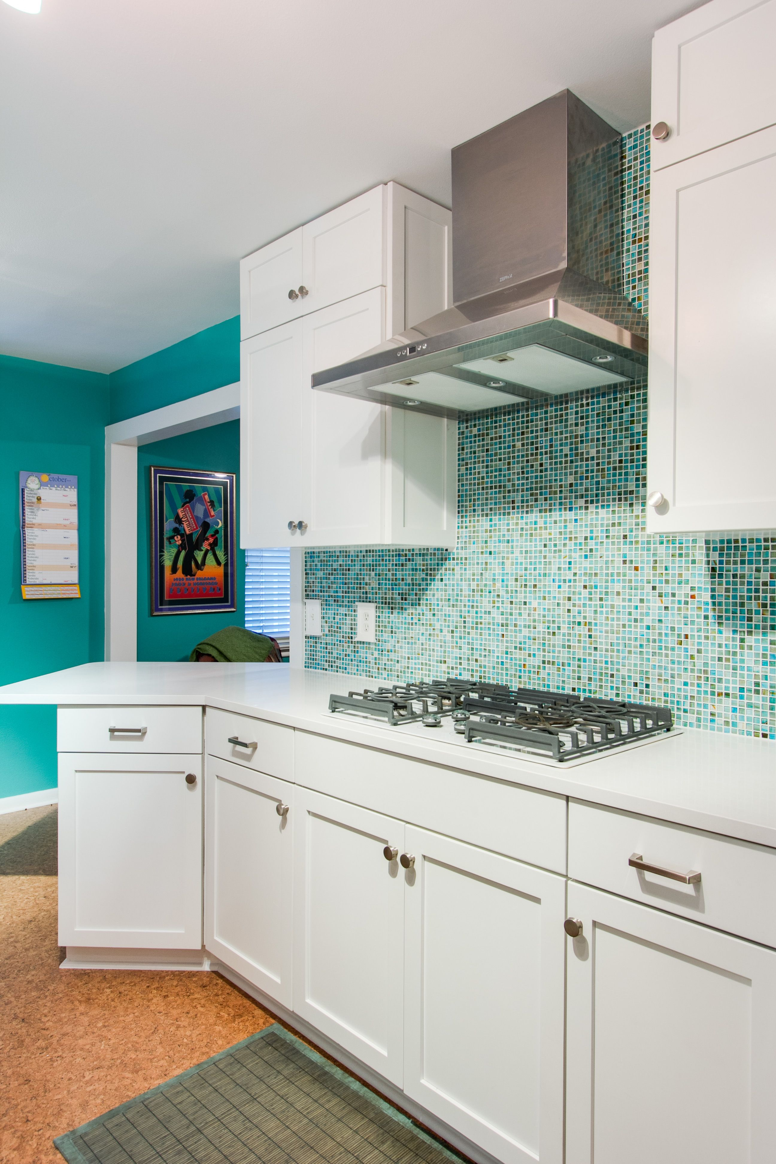 This kitchen remodel included refacing cabinets with with a white ...