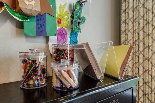 A Great, Graphic Playroom | Fun use of our Acrylic Magazine Rack for craft paper and Round Acrylic Canisters for art supplies! | Apartment Therapy