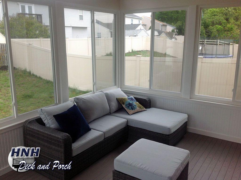 3 Season Porch Furniture 3 season room with regular sliding glass windows, painted wood