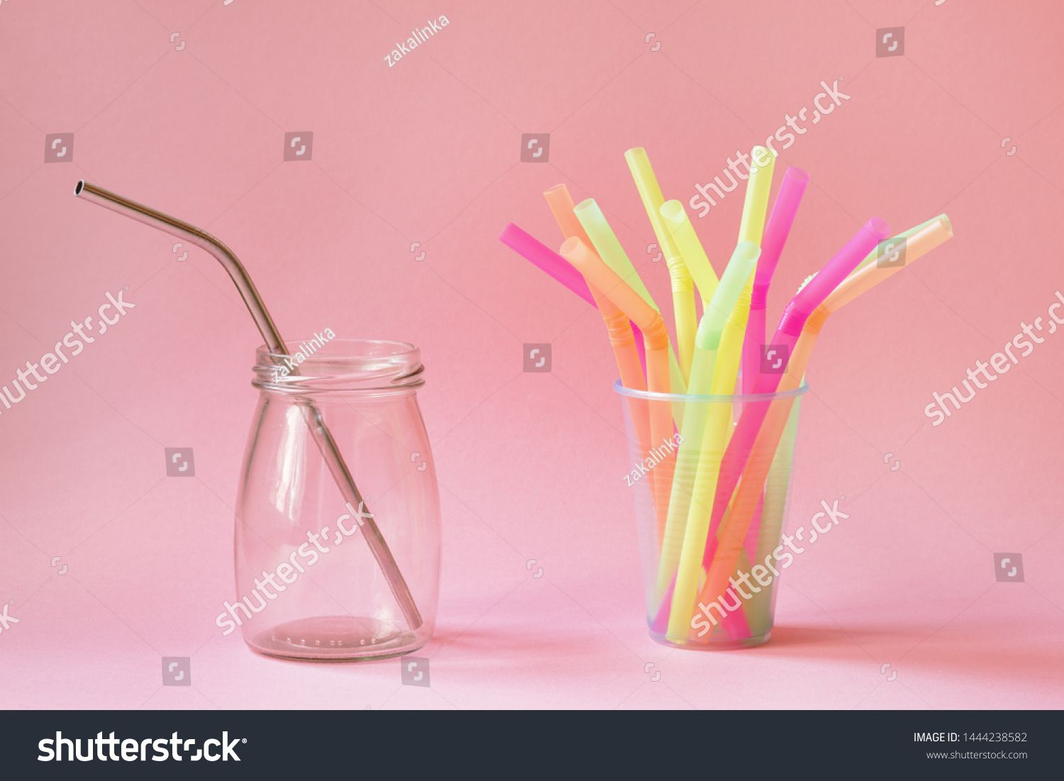zero waste and ecofriendly green lifestyle concept concept choice between reusable metal straw and plastic straws