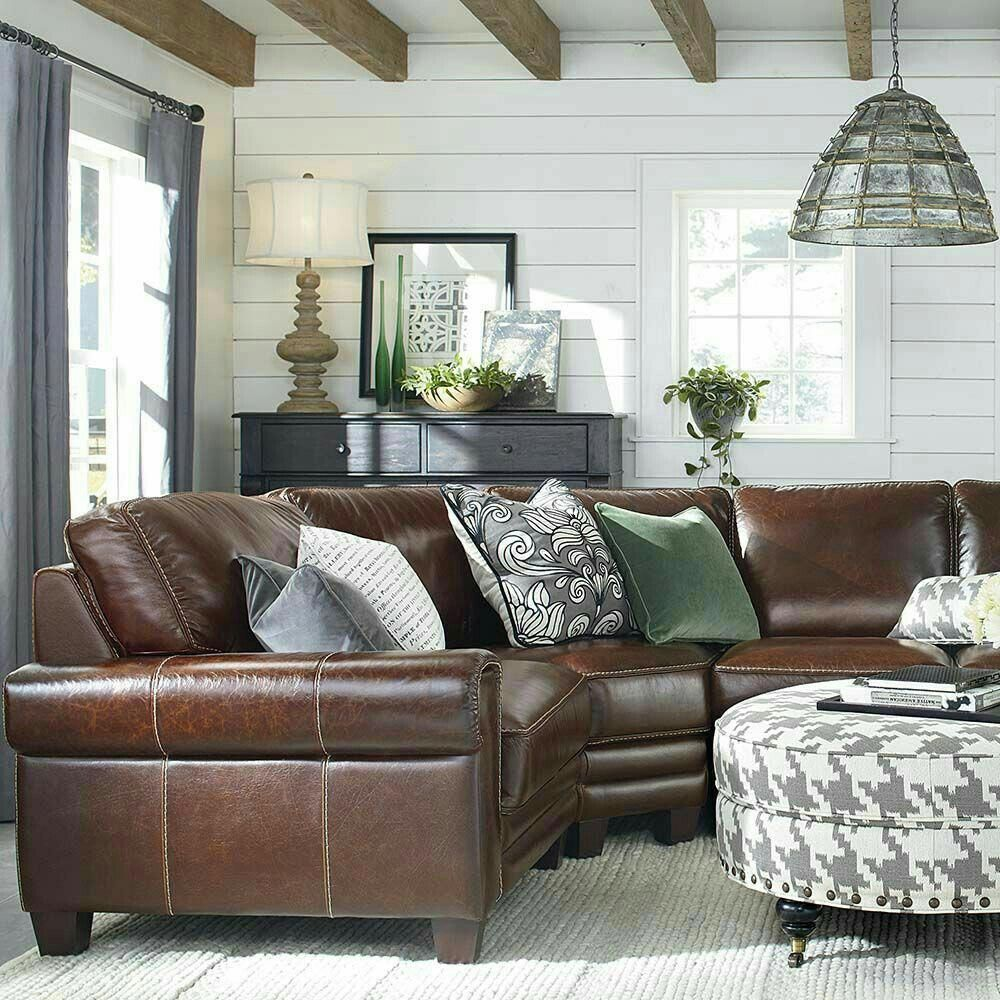 leather sectional, shiplap, and wood beams. Love the