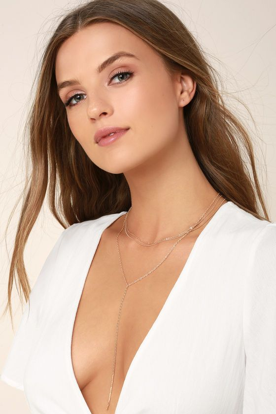 "Accessorize in minimal style with the Sleek Inspirations Gold Layered Necklace! Three layers of shiny, textured gold chains, plus a 6"" drop snake chain. Shortest necklace measures 16"" with a 3.5"" extender chain."