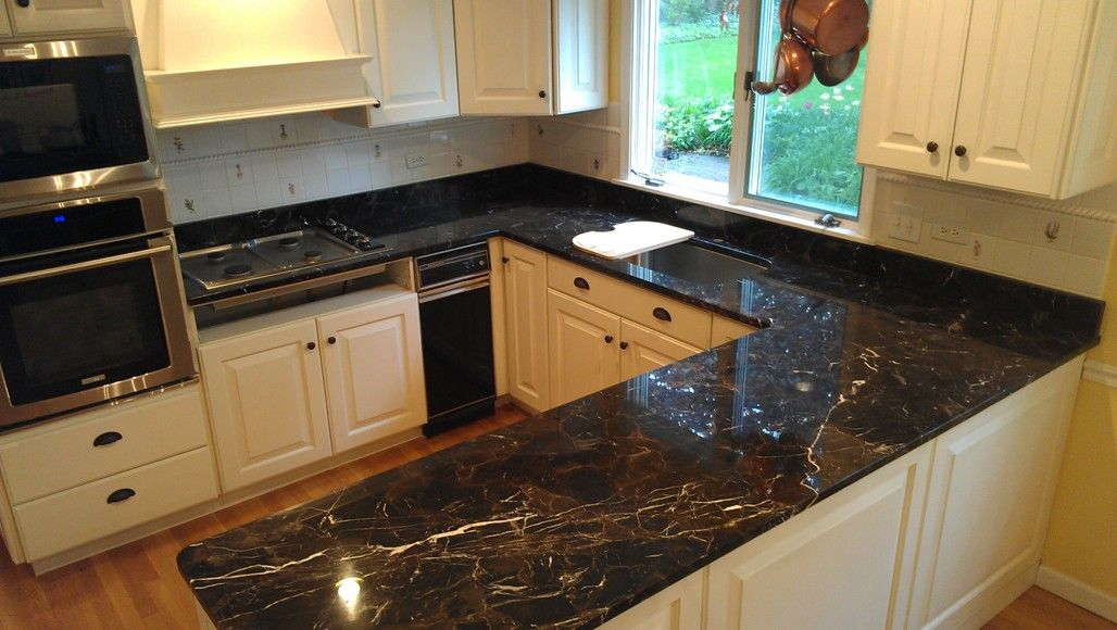 Kitchen Design Marble u-shaped-small-kitchen-design-with-sleek-black-countertops-and