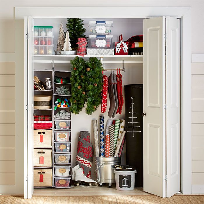 Organize Christmas decorations in a closet using hanging