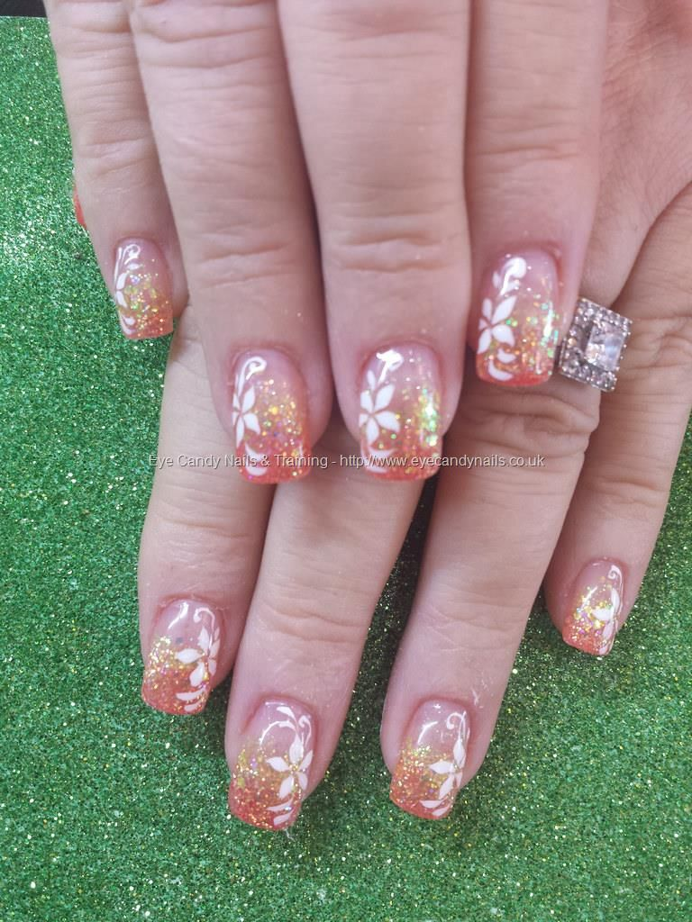Orange and yellow glitter fade with freehand nail art