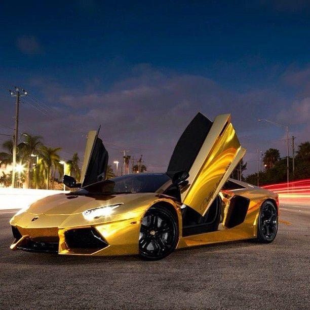 Doors Up On The Gold Lamborghini Aventador