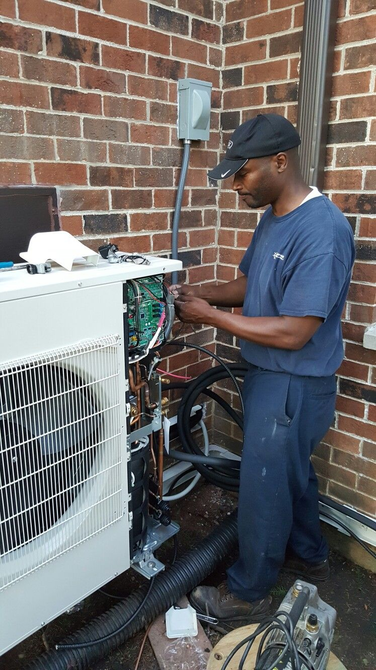 medium resolution of  heating and air technician chris wiring a mitsubishi hyper heat h2i ductless outdoor unit during conversion from a resistive electric heating system