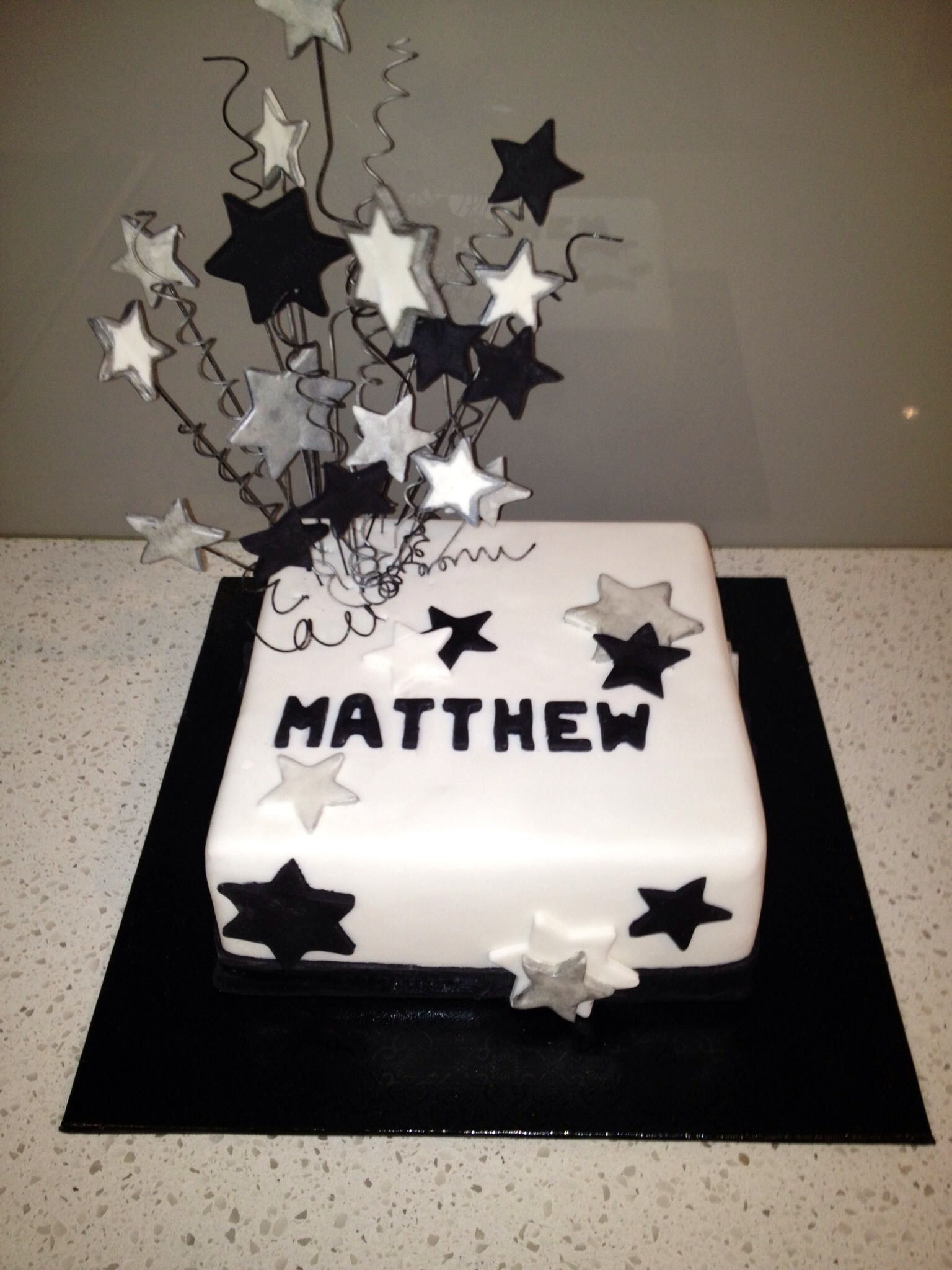 cake i made for a friends son birthday cake male star white