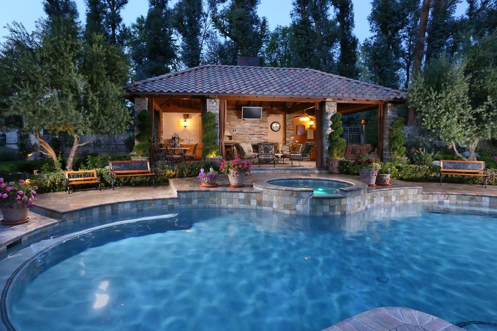 Behind The Pool Sits The Large Gazebo That Contains A Pizza Oven Fireplace Seating And Dining Area Move Seamlessly Pool Gazebo Backyard Gazebo Backyard Pool