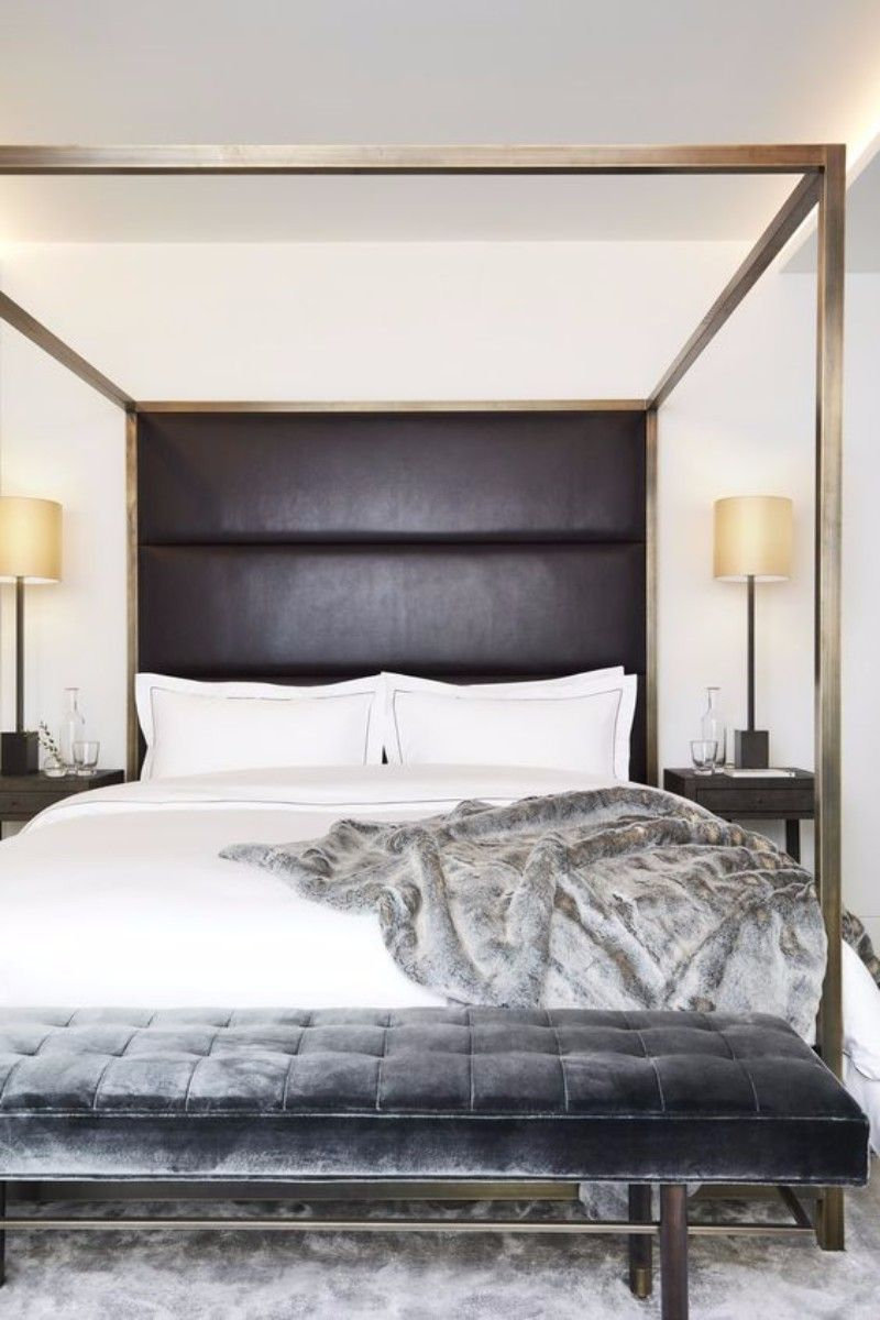 Luxurious black bedroom with a canopy bed and a charming shining ...