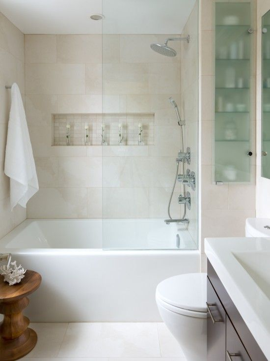 Shower tub combo for a small bathroom where space is a premium. Bathroom cupboard with glass front for perfumes and recess shelf in the shower area is ideal for shampoo bottles etc. Colour scheme in earthy tones keeping the bathroom light. #bathroom #recessshlef #bath #tiles