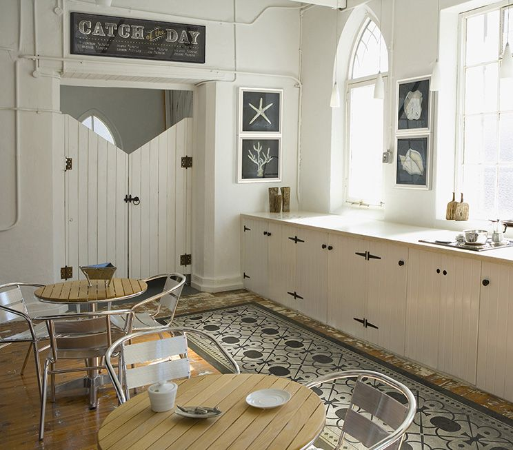 A Coastal Kitchen Featuring Artwork And Vintage Vinyl