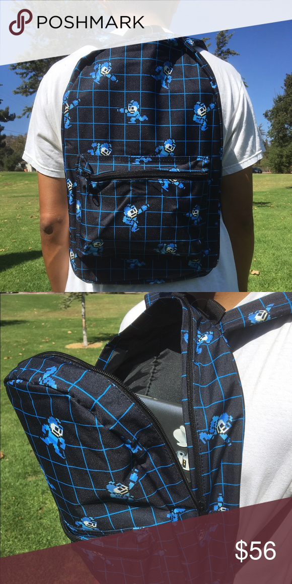 """Mega Man Backpack Nostalgic Mega Man backpack is available to take you back to those good old side scroller days! This is a regular sized backpack and the measurements are about 14"""" (width) by 18.5"""" (height). This product is licensed by Bioworld. No trades! If interested please use the offer button. Thank you! Mega Man Bags Backpacks"""