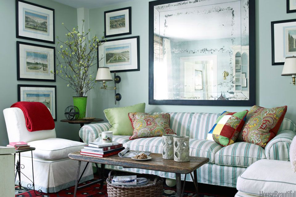 Benjamin Moore's Palladian Blue creates a feeling of calm in the TV room of a Nantucket cottage designed by Gary McBournie. Apple green and red accents spice things up. The slipper chairs are covered in Pindler the sofa, in Zoffany's Mallow, now discontinued.