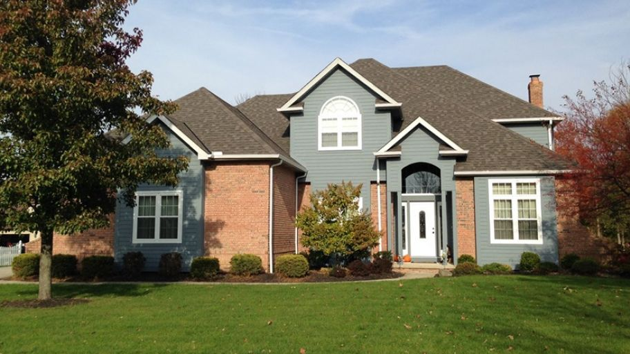 How To Mix And Match Your Home S Siding Orange Brick Houses Orange Brick Blue Siding