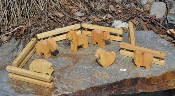 Farm animals: horse, cow, goose, pig, sheep and goat and six sections of fence to try and keep them in, which isnt always so possible. They are made of pine with an all natural oil wax finish. Here is a chance to have fun on your own farm without all the extra work that comes with a real farm.  Fences: 6 long, 1.5 tall, .75 wide Animals from: 1.75 - 3 tall, .75 wide