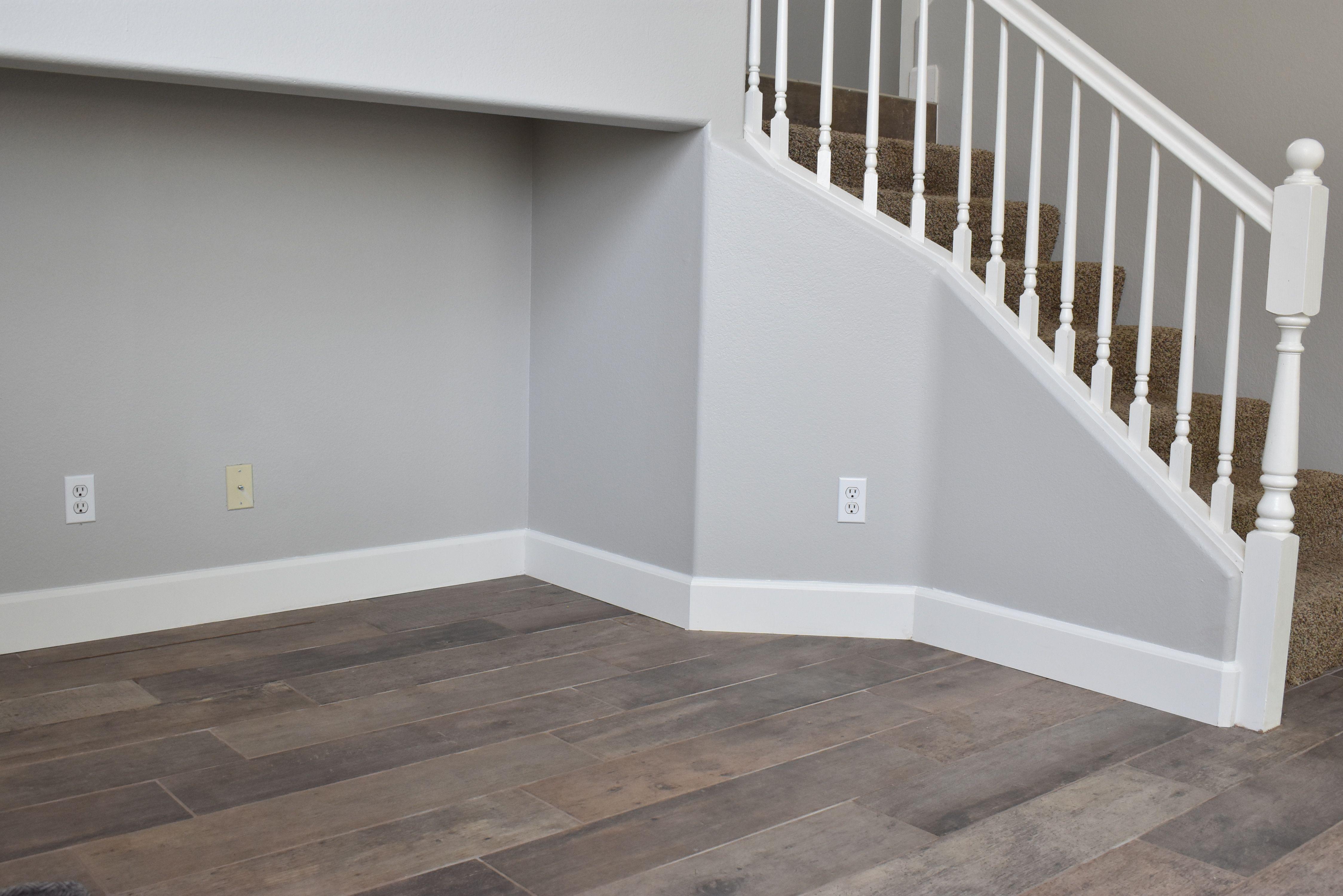 Repose gray paint, tall baseboards & porcelain tile floors