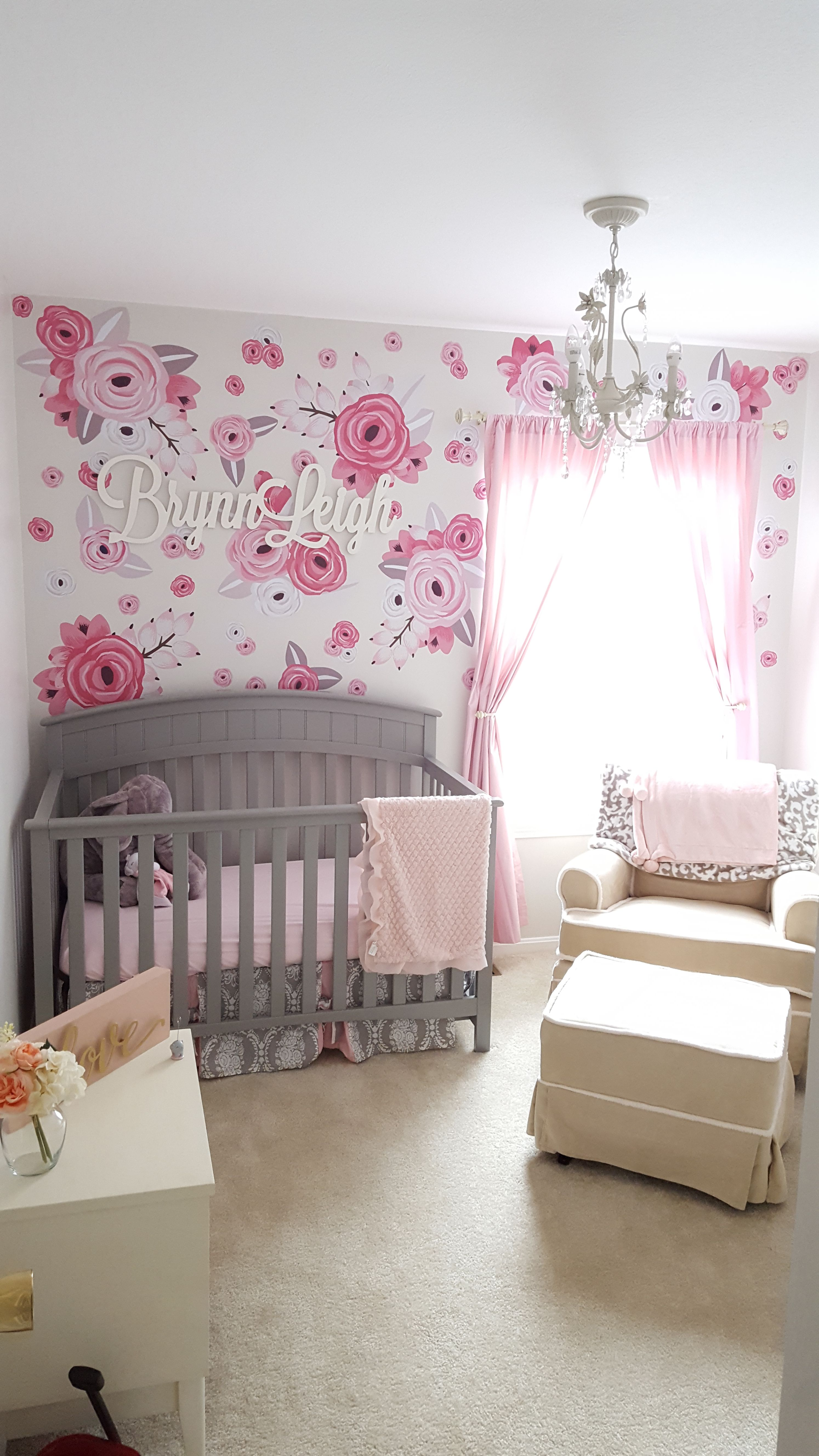 Loving our little girl nursery with urban wall floral