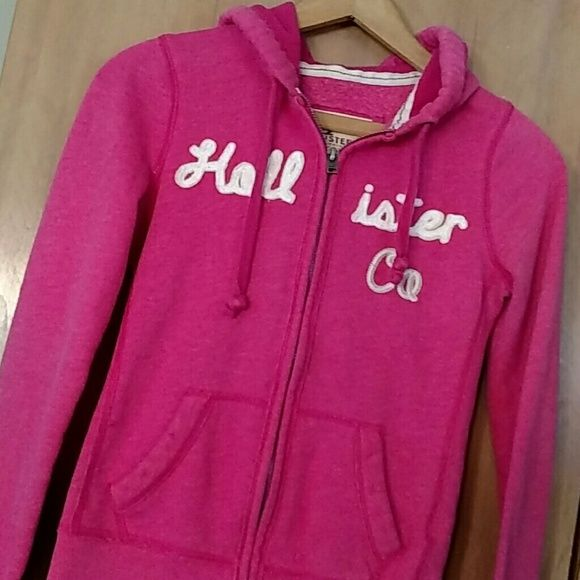 Hollister Hoodie *REDUCED* This hoodie rocks! Its in excellent condition except some wear on the arm bottoms. I tried to get a pic, the color is still very pink just didn't pick up on pic where there is minor pilling and lighter wear spots on cuffs Still this sweatshirt is super cute and a summer must have! Hollister Tops Sweatshirts & Hoodies