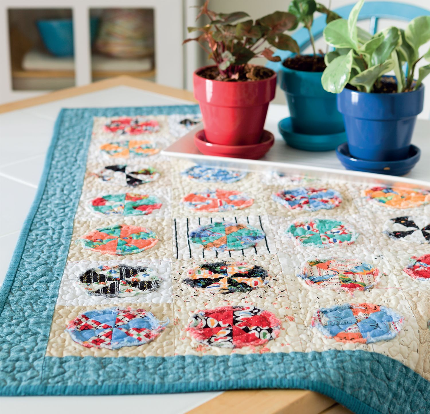 With raw-edge circles, this cute little charm quilt couldn't be quicker to make!