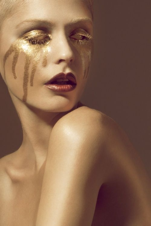 Avant Garde Woman Filled With Gold Seeping Out Of Eyes Mouth