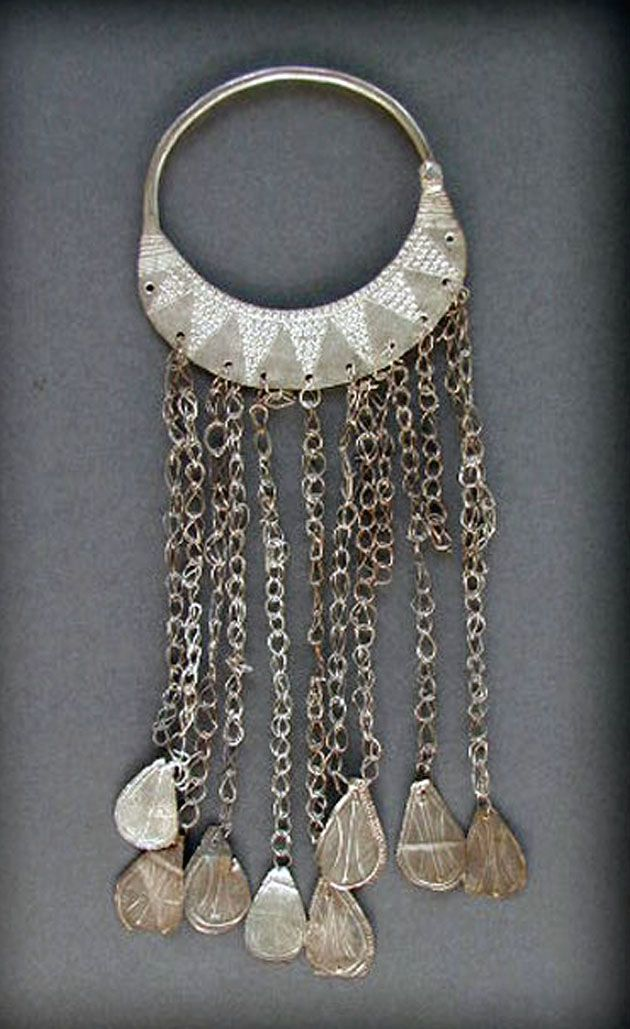 Antique silver hair ornament, from the Red Sea area. | Early 20th century | Probably from Hadendawa, one of the Beja Tribes. The upper part is made up with very good alloy of silver, but the dangles are in mixed metals. | 120$