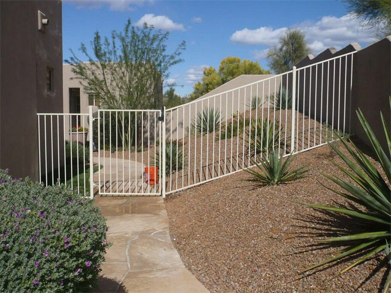 Simple white wrought iron back yard fence and gate. (With ...