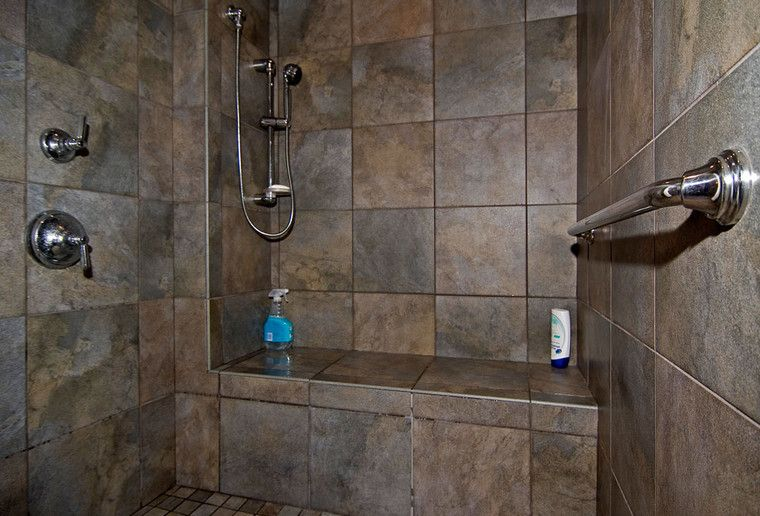 the ceramic tiled walk in shower is large to accommodate a wheelchair and has bench seating. Black Bedroom Furniture Sets. Home Design Ideas