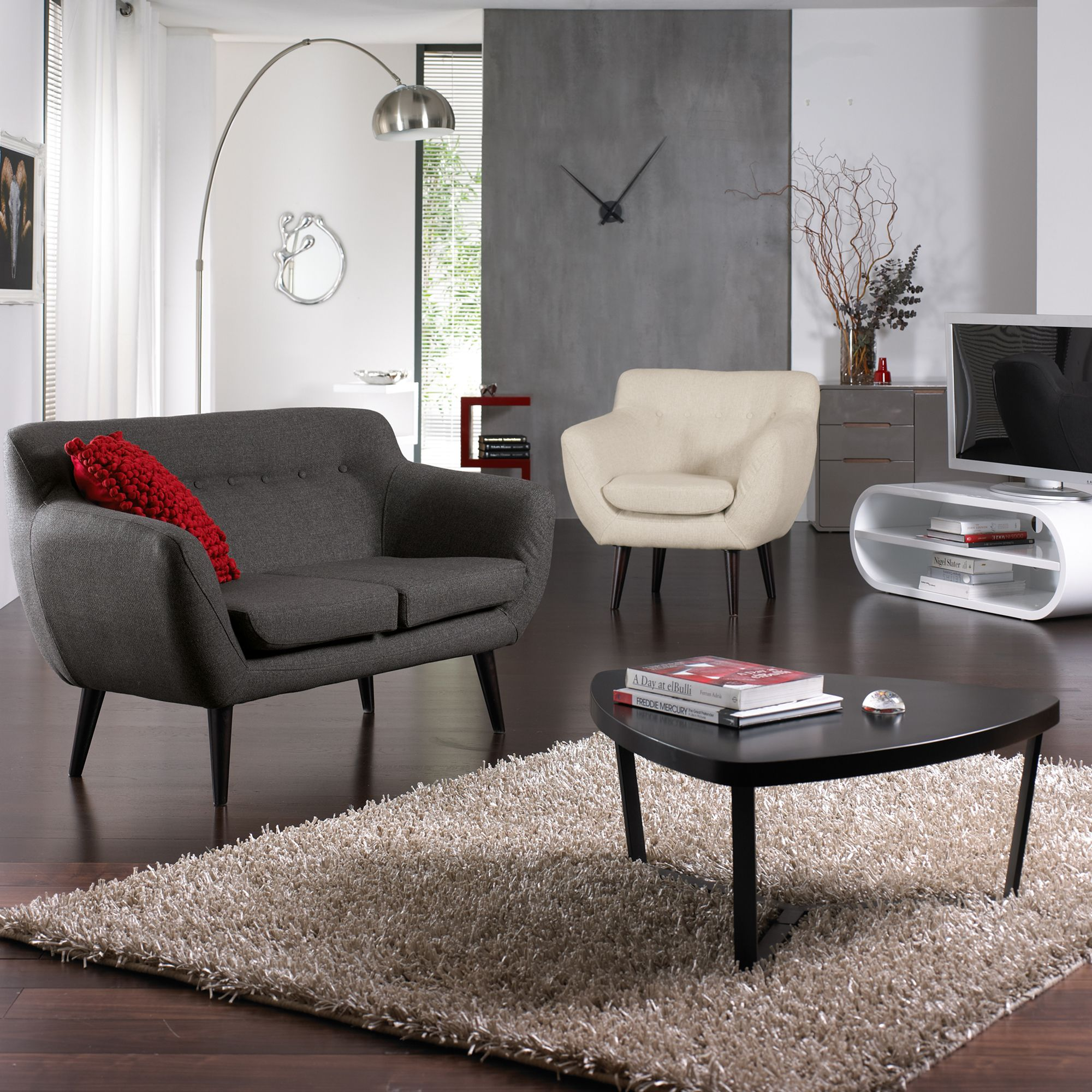 Curved lines angled legs and button detail make the retro trend