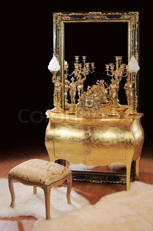 Hi-res stock photo Luxurious bronze interior items Table, big mirror, lamps, ottoman,. Discover the amazing world of our 50.000 photographers & graphic designers worldwide.