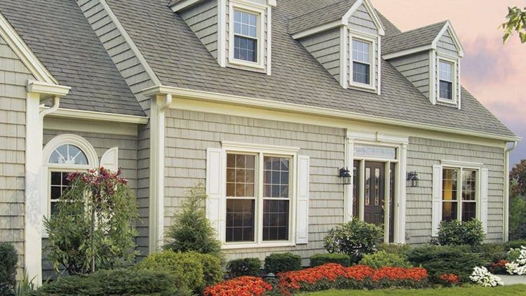Cape Cod House With Grades Of Colours Cape Cod Exterior Cape Cod Style House Vinyl Siding Styles