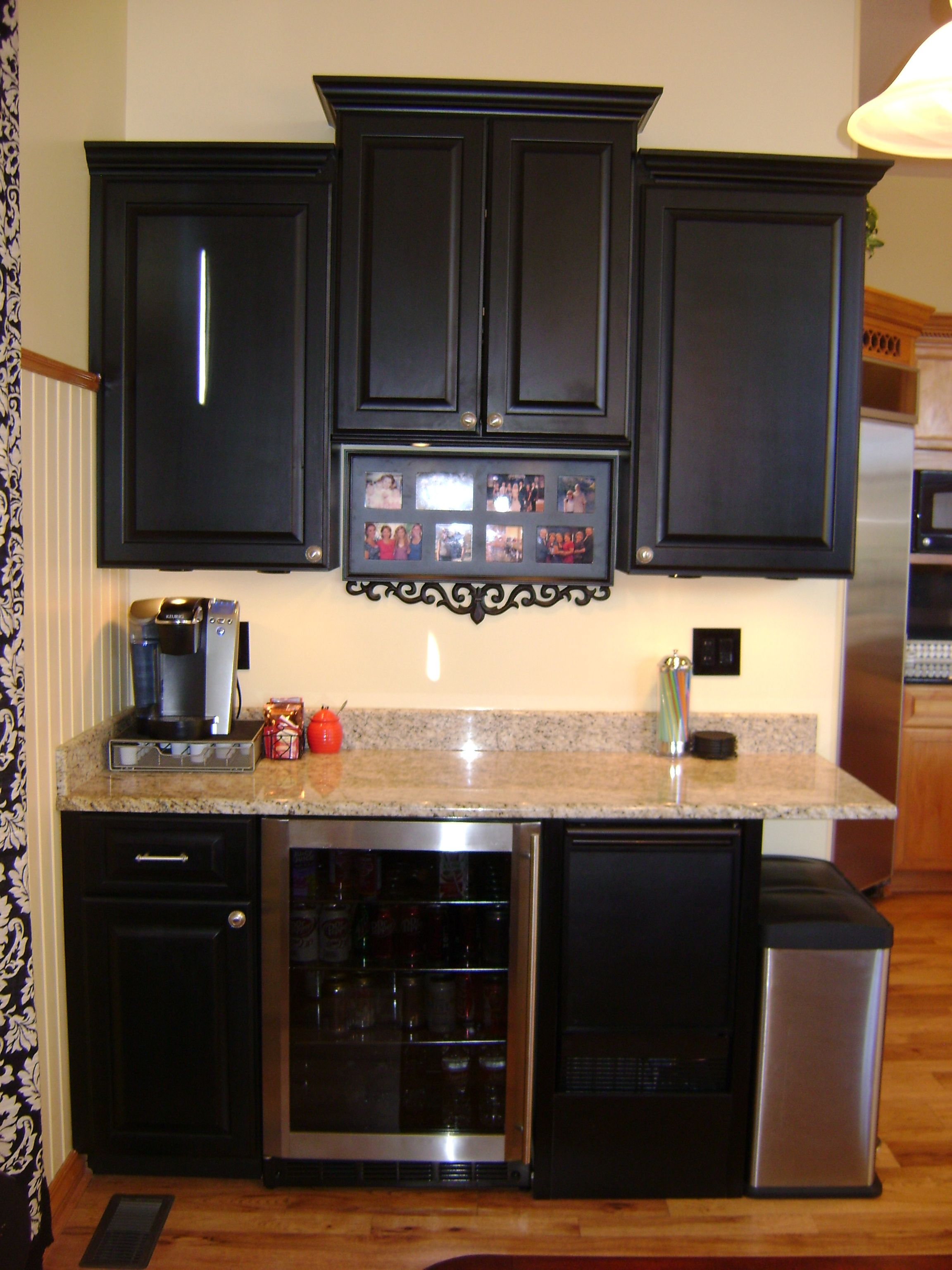 added black maple beverage center and granite. kitchen tune-up