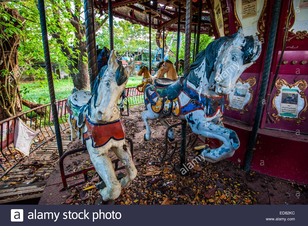 Decaying Horses On Carousel At Abandoned Amusement Park In Yangon Stock Photo Royalt Abandoned Amusement Park Abandoned Theme Parks Abandoned Amusement Parks